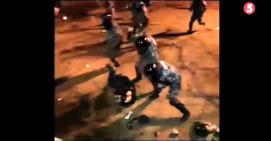 A screenshot from the video of the police attack on December 1, 2013